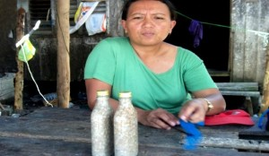 Woman selling green mussels, Samar, Leyte, Philippines. Source: Marieta Banez Sumagaysay