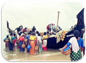 At the beach, women fish buyers meet a ring seine fishing boat on its return from the sea. Source: Nikita Gopal