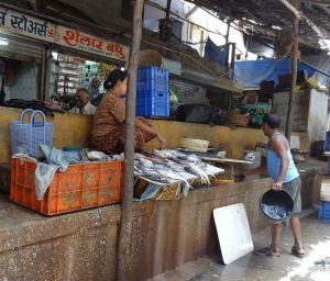 A woman selling fish from her small stall in an outer area of a Mumbai fish market. Photo: Shudawathi Peke.