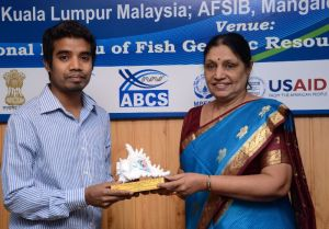 GAF5 Best Paper Award winner, S. Inaotombi, receiving his Award from Dr B. Meenakumari, DDG (Fisheries), ICAR (Organizing Committee Co-Chair).