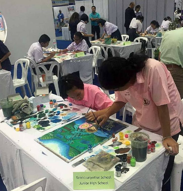 Teams working on their paintings at the Youth and Fish competition, 4 August, BiTEC, Bangkok. Photo: Competition organisers.