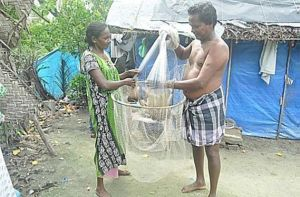 Kerala fisher couple with cast net and scoop net. Photo: Sruthi P.